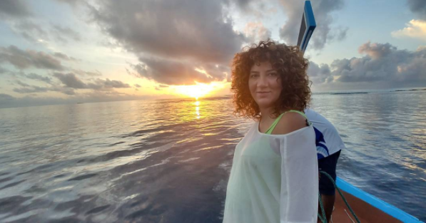 Aline- enjoying a sunset trip at Constance Halaveli Maldives